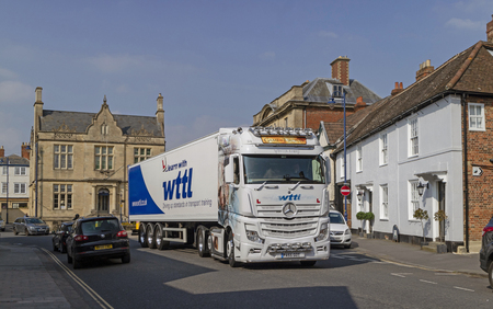 Devizes, Wiltshire, England, UK. March 2019. Learner driver on a transport training course using a artic lorry in Devizes town centre.