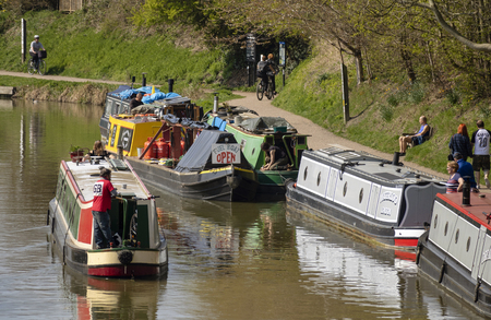 Narrow boats on the Kennet and Avon Canal, Devizes, Wiltshire, England, UK. March 30th 2019. Visiting fuel and supply boat for refueling the canal users. Picture: Peter Titmuss/ Alamy News Live