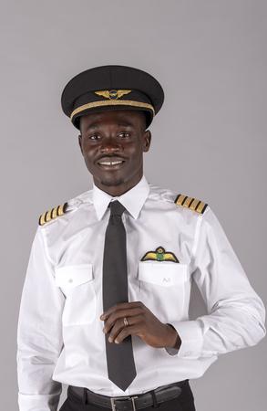 Portrait of a young airline pilot wearing a captain's uniform.