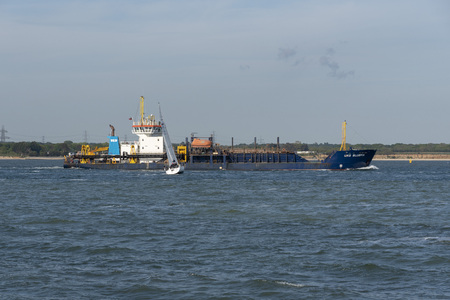 Southampton, England, UK. May 2019.  The UKD Bluefin a trailing suction hopper dredger ship underway on Southampton Water, UK. Editorial
