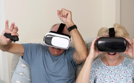 Portsmouth UK, May 2019. Elderly couple having fun wearing virtual reality goggles Stock Photo