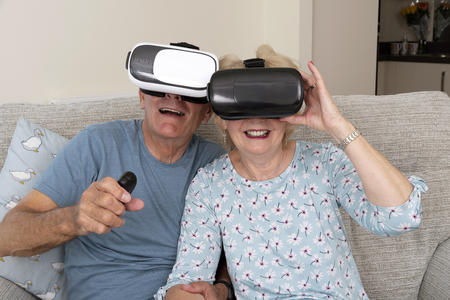 Portsmouth UK, May 2019. Elderly couple having fun wearing virtual reality goggles Stock fotó