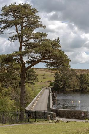 Road crossing a dam on the Venford Reservoir near Holne on Dartmoor.