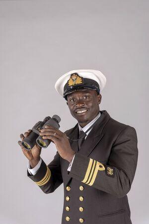 A naval officer in uniform holding a pair of binoculars Reklamní fotografie