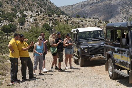 Crete, Greece, June 2019. Tourists on a mountain safari with 4x4 vehicles in the Selena Oros mountains central Crete.