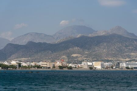 Crete, Greece. June2019. Southern Crete and the town of Ierapetra with the Church of Agia Fotini and mountains close to the waterfront