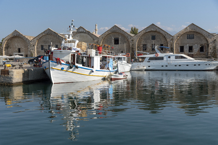 Chania, Crete, Greece. June 2019. Fishing boats on their moorings in the Cretan Old Venetian Harbour at Chania western Crete.