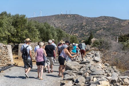 Kato Seles, northern Crete, Greece. October 2019.  A tourist group on a walking tour in countryside with a mountain backdrop close to Seles in Northern Crete