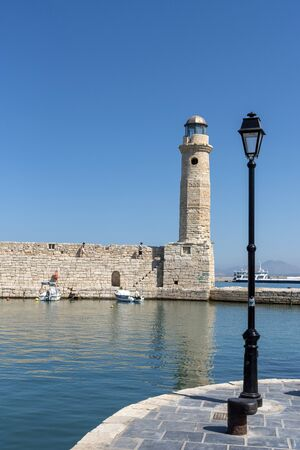 Rethymno, Crete, Greece. October 2019. The ancient lighthouse on the old historic Venetion Harbour at Rethymno, Crete. 報道画像