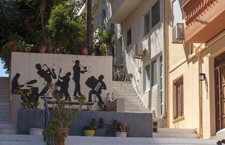 Agios Nikolaus, northern Crete, Greece. October 2019. Outdoor art showing musicians playing their instruments.