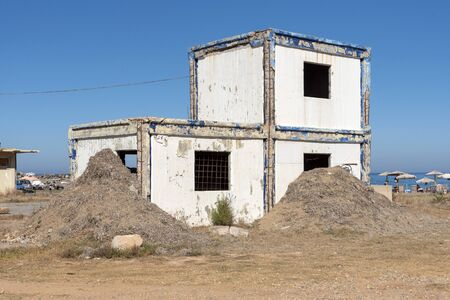 Gouves, Heraklion, Crete, Greece. October 2019. Derelict buildings of the now disused American air force base on the coast at Gouves near Herkalion, Crete.