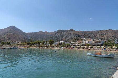 Elounda, northern Crete, Greece. October 2019. The beach  at Eloundawith a backdrop of Mountains.