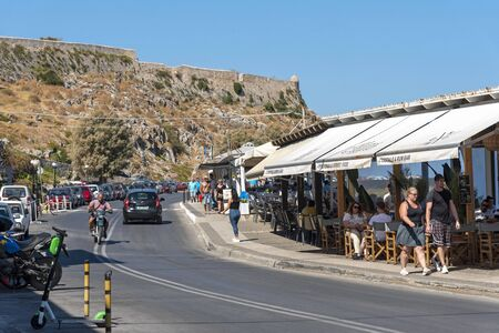 Rethymno, Crete, Greece. October 2019. The ancient Fortetza a historical fort overlooks the town and seafront restaurants of Rethymno, Crete.