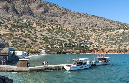 Plaka, Crete, Greece. October 2019.  Passengers wait to board a ferry to Spinalonga Island from a landing stage in Plaka, Crete, Editorial