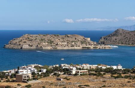 Spinalonga Island, northern Crete, Greece, October 2019. The former leper colony of Spinalonga Island viewed fron the coastal town of Plaka,
