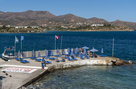 Agios Nikolaus, northern Crete, Greece. October 2019. A sunbathing pier on the Mirabella Sea close to Ammoudi Beach at Agios Nikolaos