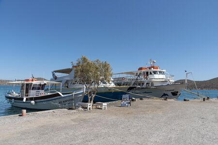Elounda; northern Crete; Greece. October 2019.; Tour boats berthed on a quay in Elounda waiting for business