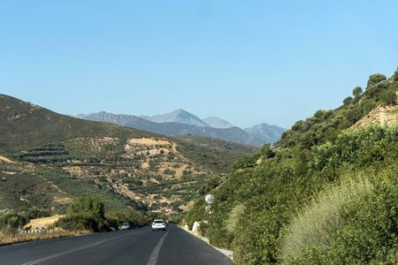 Crete, Greece. October 2019. Following a white police car on the E75 National Road close to Rethymno, northern Crete.