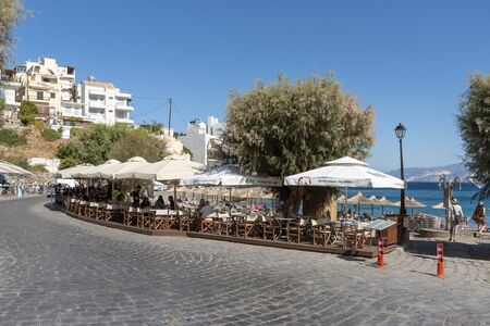 Agios Nikolaos, eastern Crete, Greece. October 2019.  The small Kitroplatia Beach, close to the town centre of Agios Nikolaos. Editorial