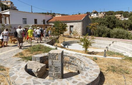 Vrouchas, Crete, Greece. October 2019.  Tourists visiting a community centre and the modern amphitheater in the mountain village of Vrouchas. Editorial
