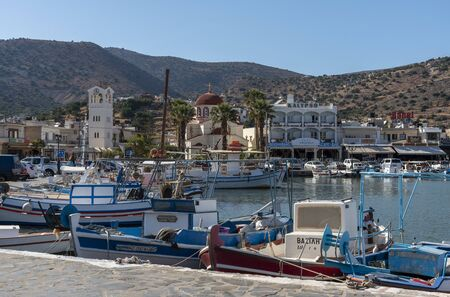 Elounda, northern Crete, Greece. October 2019.  Small fishing boats on the harbour at Elounda a popular holiday resort in northern Crete