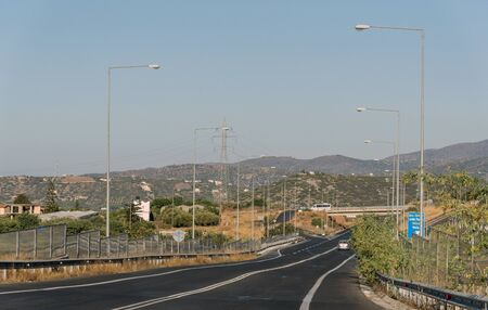 Crete, Greece. October 2019.  Approaching the turn off for Malia on the E75 National Road in northern Crete.