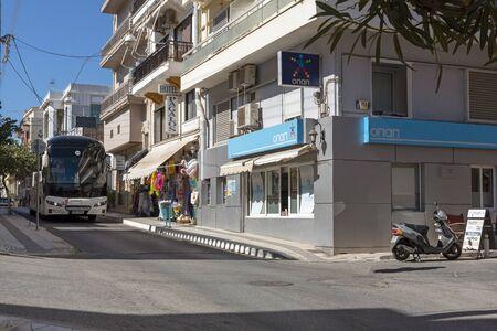 Agios Nikolaos, eastern Crete, Greece. October 2019.  A tour bus on a narrow street in the town centre of Agios Nikolaos.