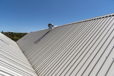 Elgin, Western Cape, South Africa. December 2019. An overview of a new new roof with an extractor fan
