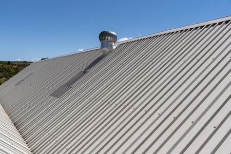 Elgin, Western Cape, South Africa. December 2019. An overview of a new new roof with an extractor fan 스톡 콘텐츠 - 138475147