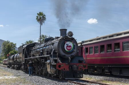 Ceres, Western Cape, South Africa. December 2019.  Diesel powered steam engine at the Cherry Festival on Ceres golf estate being checked before departing to Cape Town