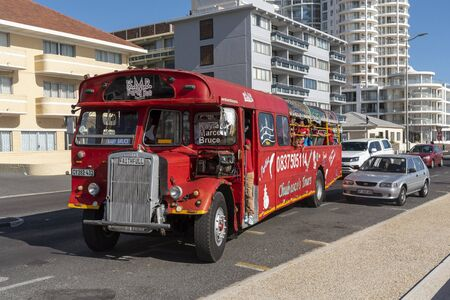 Strand, Western Cape South Africa. Dec 2019. Vintage fun and party red bus at Strand a populat seaside resort in the Western Cape, South Africa.