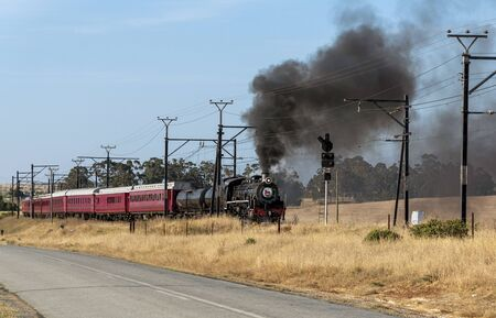 Hermon, Swartland, South Africa. December 2019. Oil burner vintage black locomotive seen passing Hermon in the Swartland region bound for Cape Town