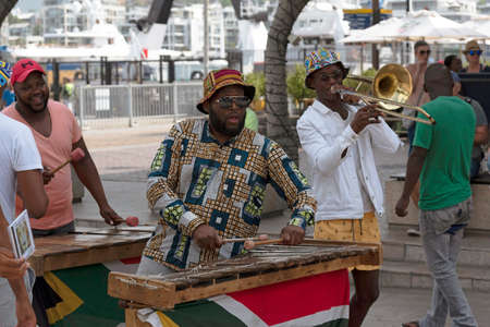 Cape Town, South Africa. December 2019. Street musician plays xylophone on the waterfront area of central Cape Town.