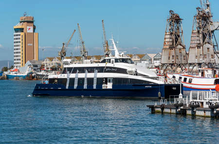 Cape Town, South Africa. 2019. Passengers and the Robben Island fast ferry, Krotoa on the waterfront in Cape Town.