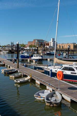 Lymington, England, UK. May 2020. Berthing pontoon and small boats at the Town Quay, Lymington, Hamshire, England UK