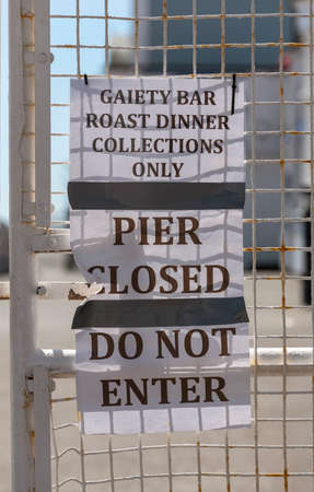 Southsea, Portsmouth, England, UK, May 2020. Southsea Pier locked entrance gates and notice, pier closed, during Covid-19 outbreak
