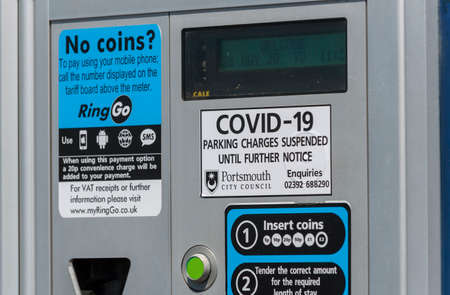 Southsea, Portsmouth, England, UK. 26 May 2020. Covid-19 notice on parking ticket machine. Parking charges suspended on the seafront at Southsea, Portsmouth, UK