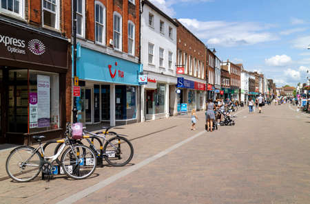 Newbury, Berkshire, England, UK. June 2020.  Newbury High Street open again for business during Covid-19 outbreak. Most shops closed and very few people.