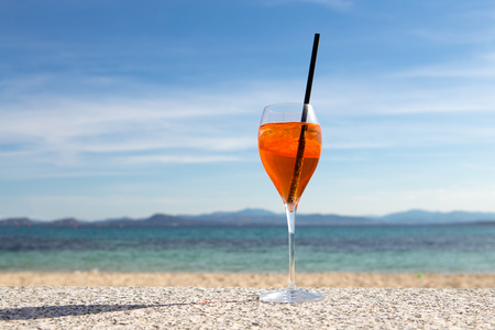 glas of aperol spritz in the sun on a seaside terrace Stock Photo