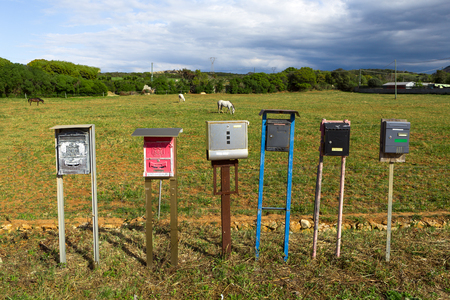 mailboxes messed up together  in a meadow