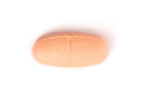 close-up van een zachte roze pil van bovenaf geïsoleerd op een witte achtergrond.psd Stockfoto