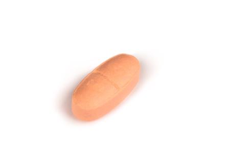close-up van een zacht roze pil geïsoleerd op een witte backgound.psd Stockfoto