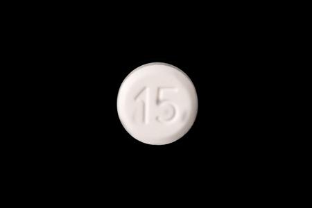 close-up van een witte pil geïsoleerd op een zwarte background.psd Stockfoto