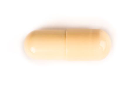 close-up van een gele pil van bovenaf geïsoleerd op een witte background.psd