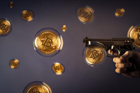 veel bitcoin bubbels en een pistool wijzend op een bubbel