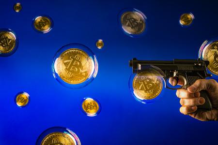veel bitcoin bubbels en een pistool gericht op een bubbel