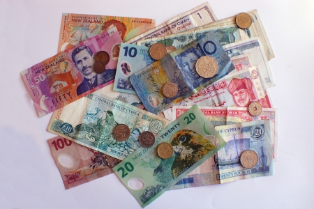 Assorted banknotes and coins from New Zealand, Australia; Cyprus; Oman; Japan and Malaysia photo
