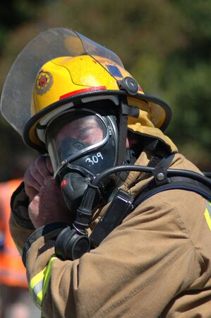 Fireman adjusts his breathing apparatus