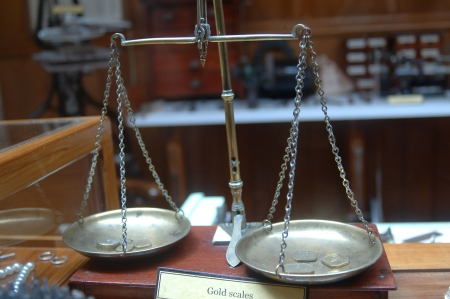 Old set of balance scales for weighing gold