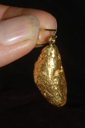 Natural gold nugget set as pendant photo